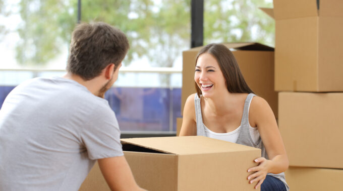 First-Time-Home-Buyers-Young-Couple-Lifting Box-Moving-Park-Place-Finance-park-place-finance