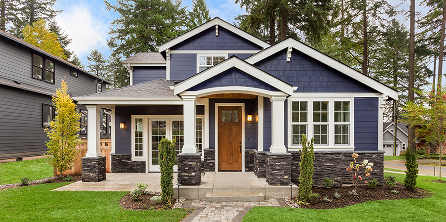Mid-size-blue-house-exterior-with-wooden-door