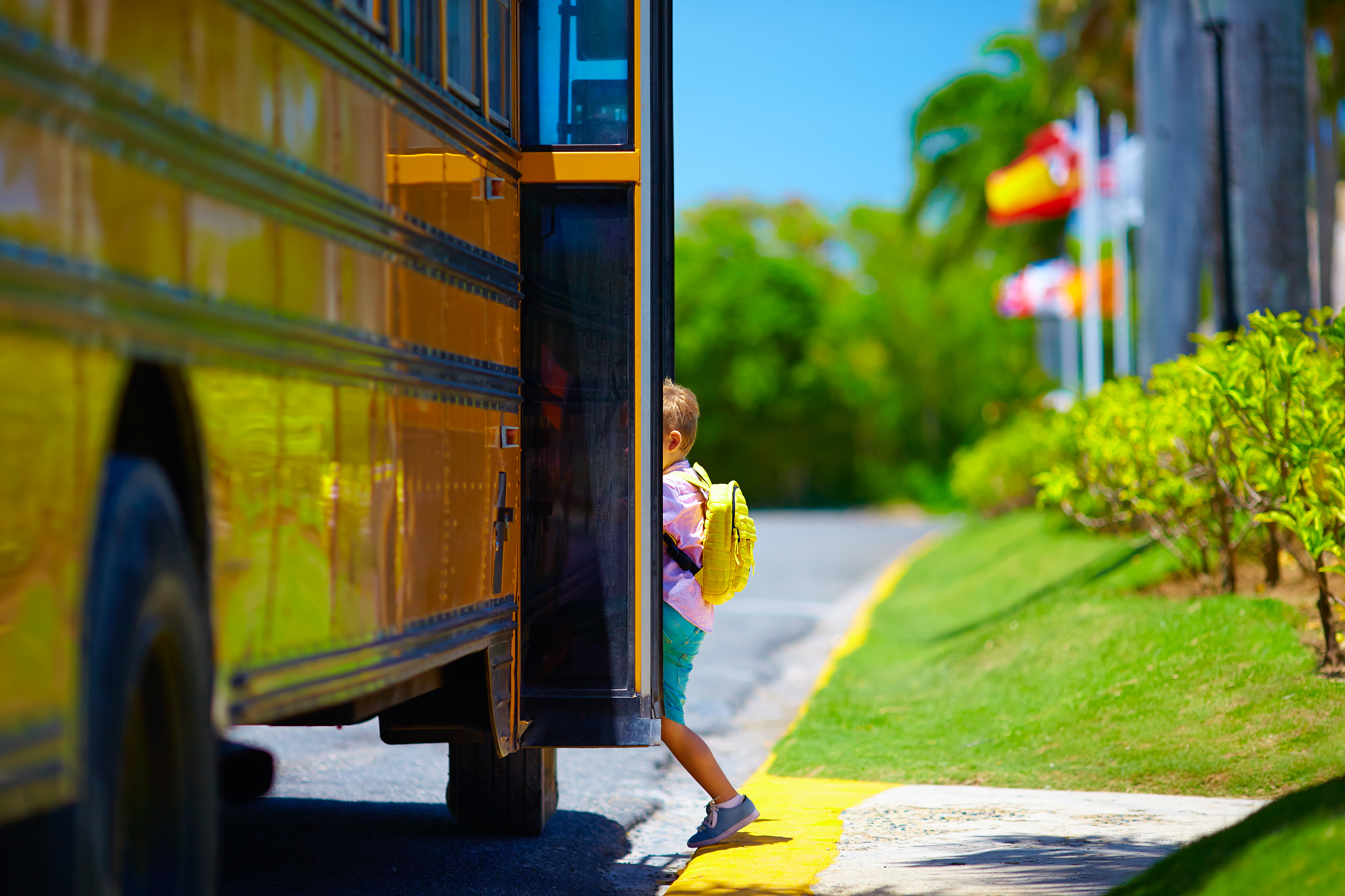 young-boy-kid-getting-on-the-schoolbus