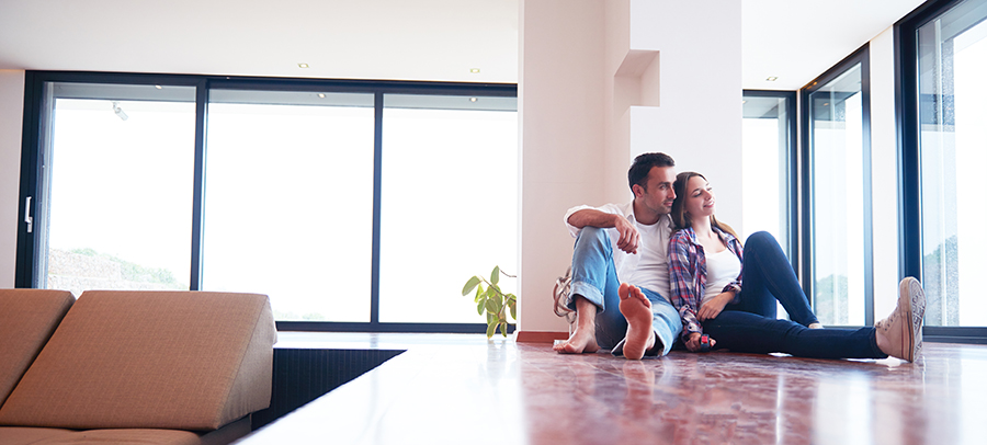 Couple-sitting-on-floor-new-house-park-place-finance