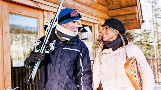 Man and Woman with skis and snowshoes
