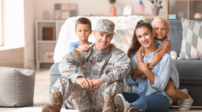 Military Veteran At Home With Wife And Two Children