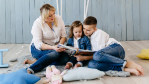 mom with children reading a book